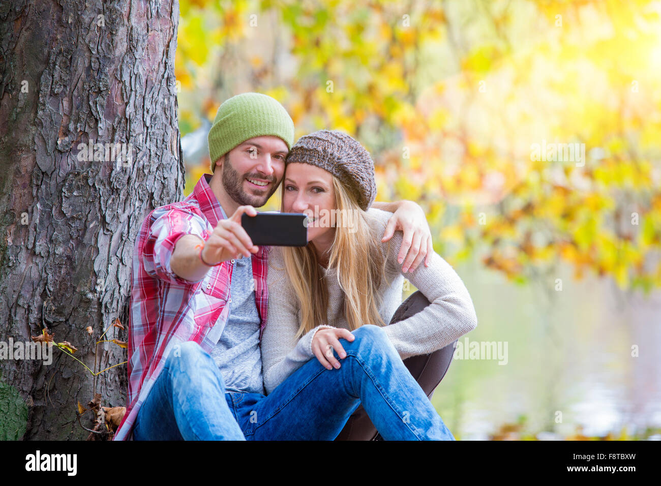Young couple dating in forest - Stock Image