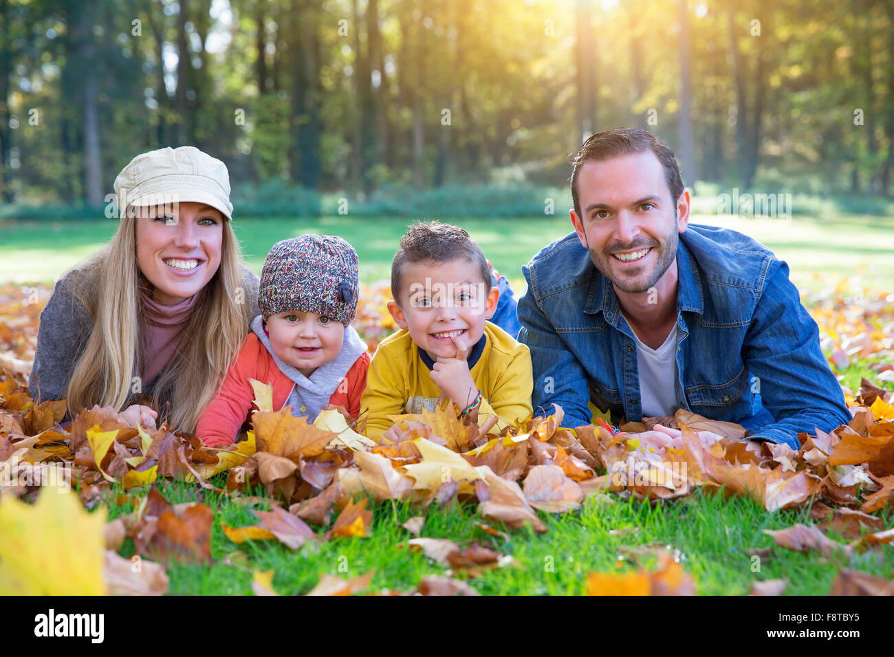 Portrait of a family lying down - Stock Image