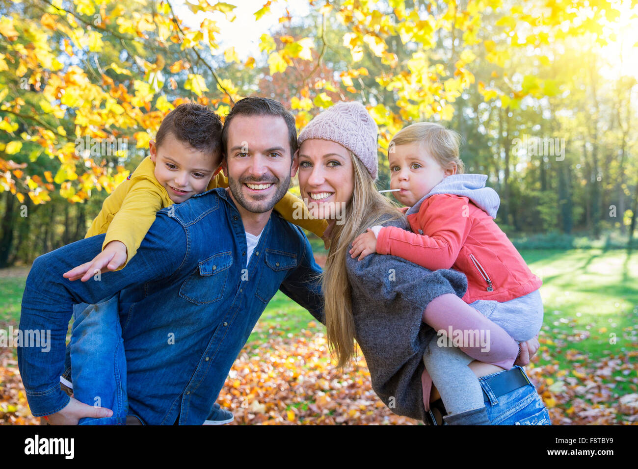 Portrait of a family in park - Stock Image