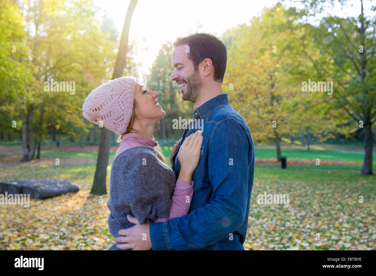 Young couple dating in Park - Stock Image
