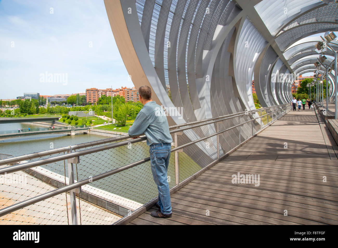 Man at the viewpoint in the Perrault bridge. Madrid Rio, Madrid, Spain. - Stock Image