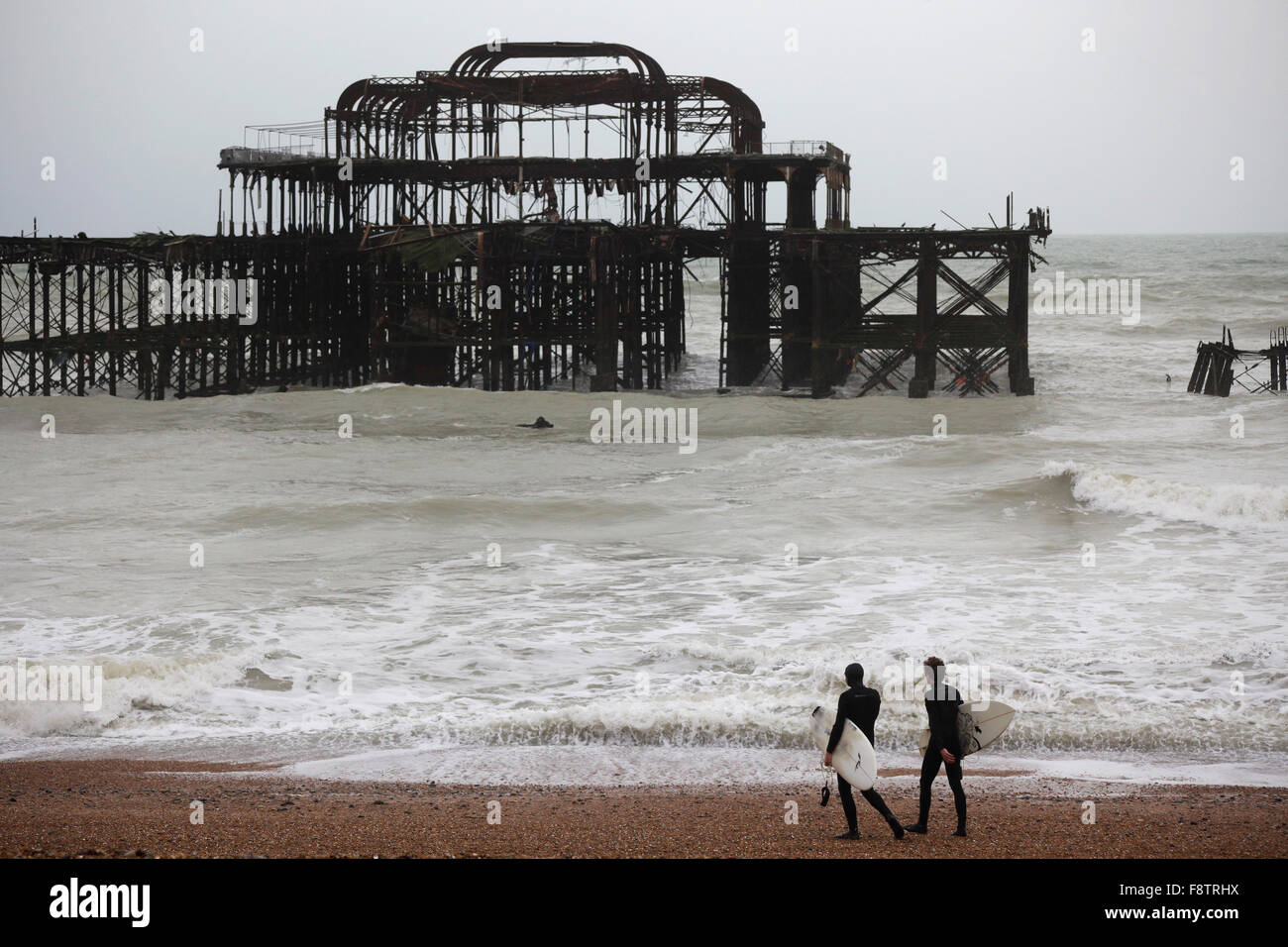 Brighton old west pier with flying starlings. UK, England. Stock Photo