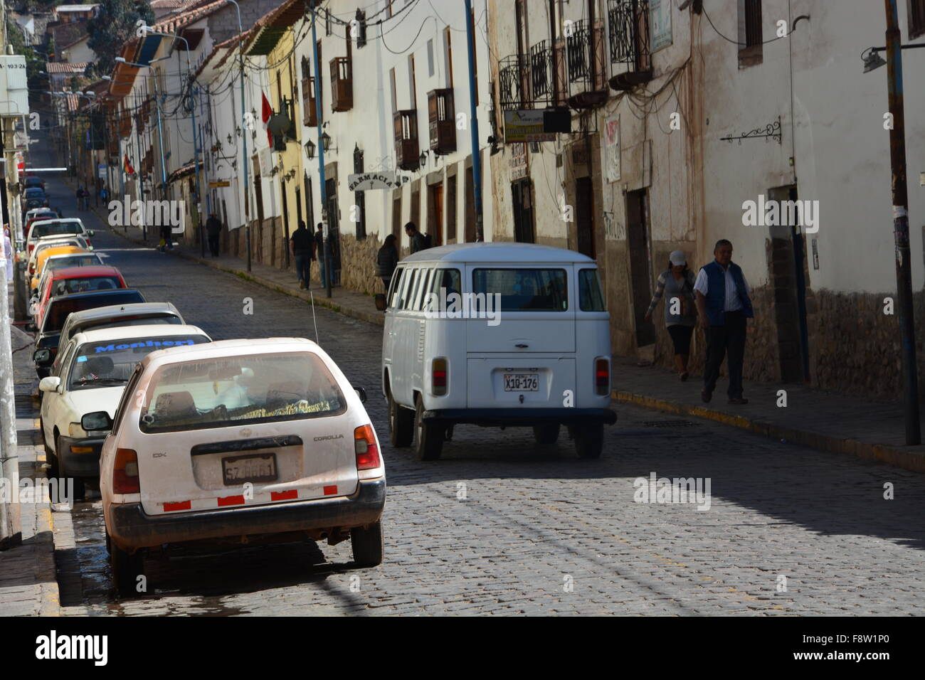 A white Brazilian 14 window VW Bus / Kombi on the streets of Cusco Peru. - Stock Image