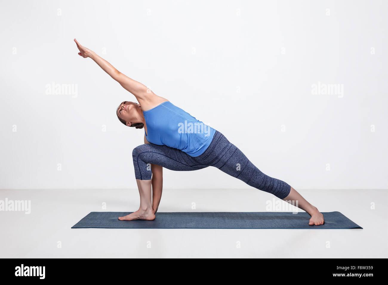 Woman doing Ashtanga Vinyasa Yoga asana - Stock Image