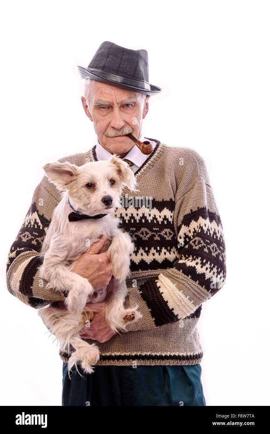 Cute grandpa with a dog sitting on his hands. - Stock Image