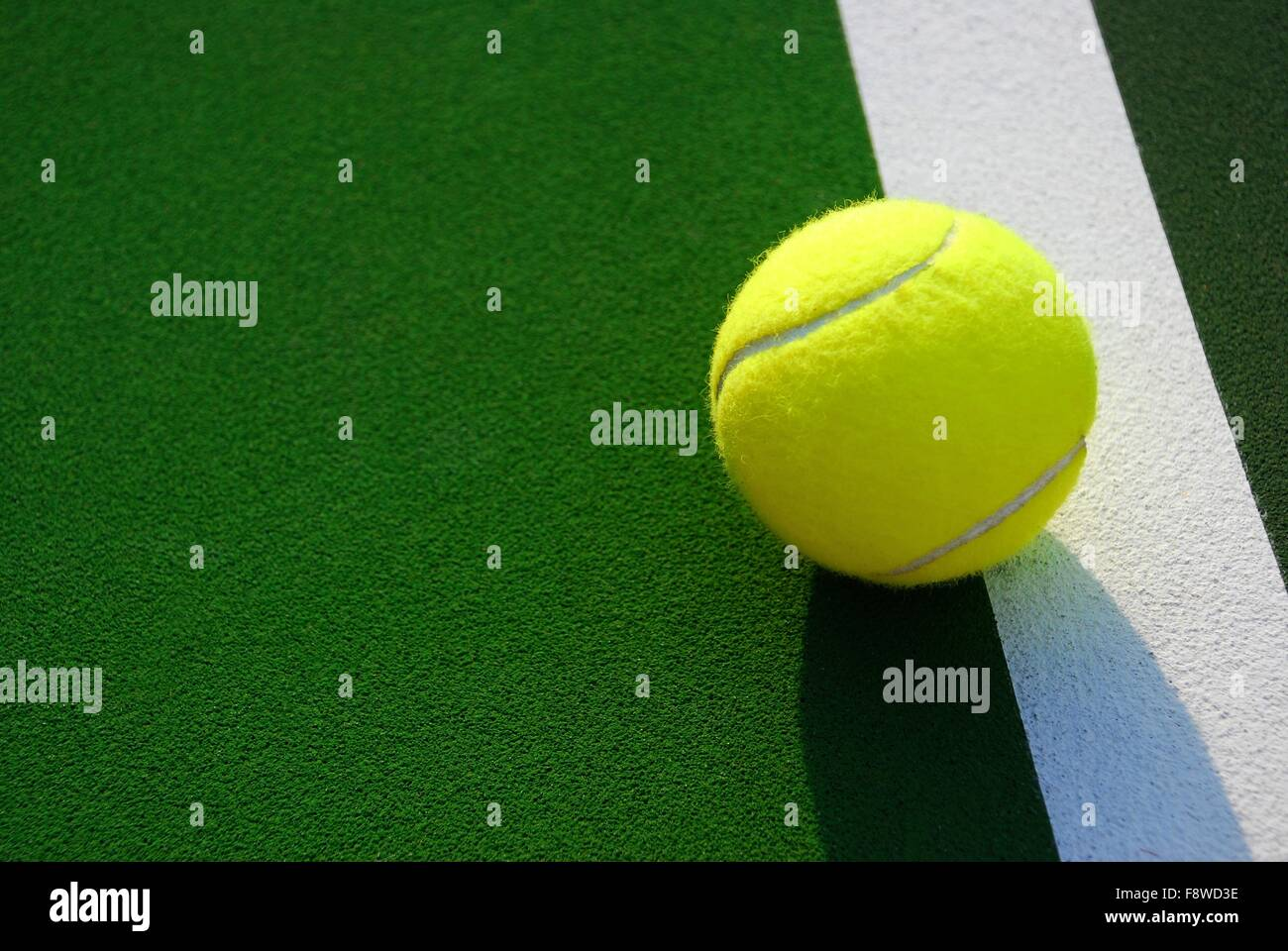 Yellow Tennis Ball on Foul Line - Stock Image