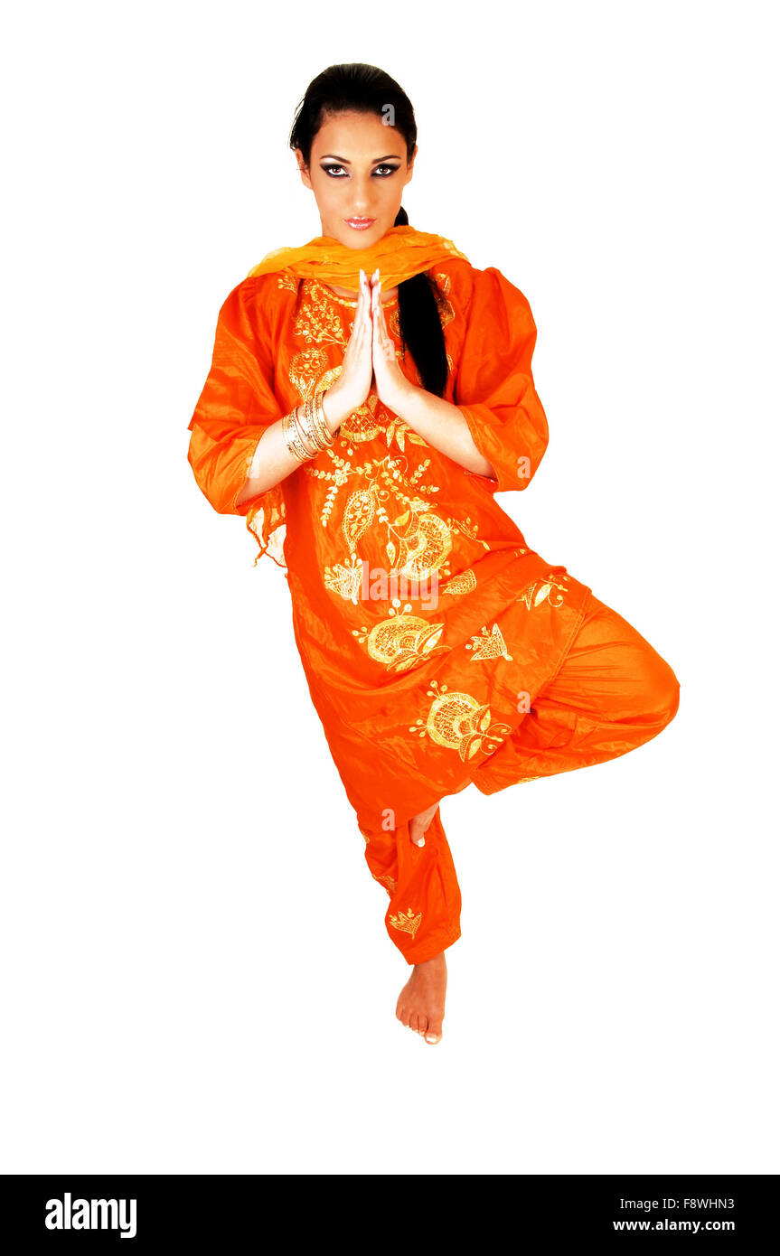 A beautiful young east indian teen girl standing on one foot in her nice traditional indian orange dress folding her hands for  sc 1 st  Alamy & A beautiful young east indian teen girl standing on one foot in her ...