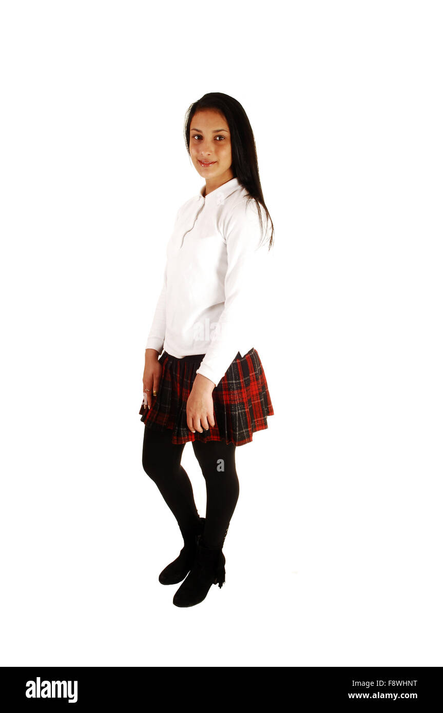 e025a8bfb A teenage girl standing for white background in her school uniform with her  long black hair
