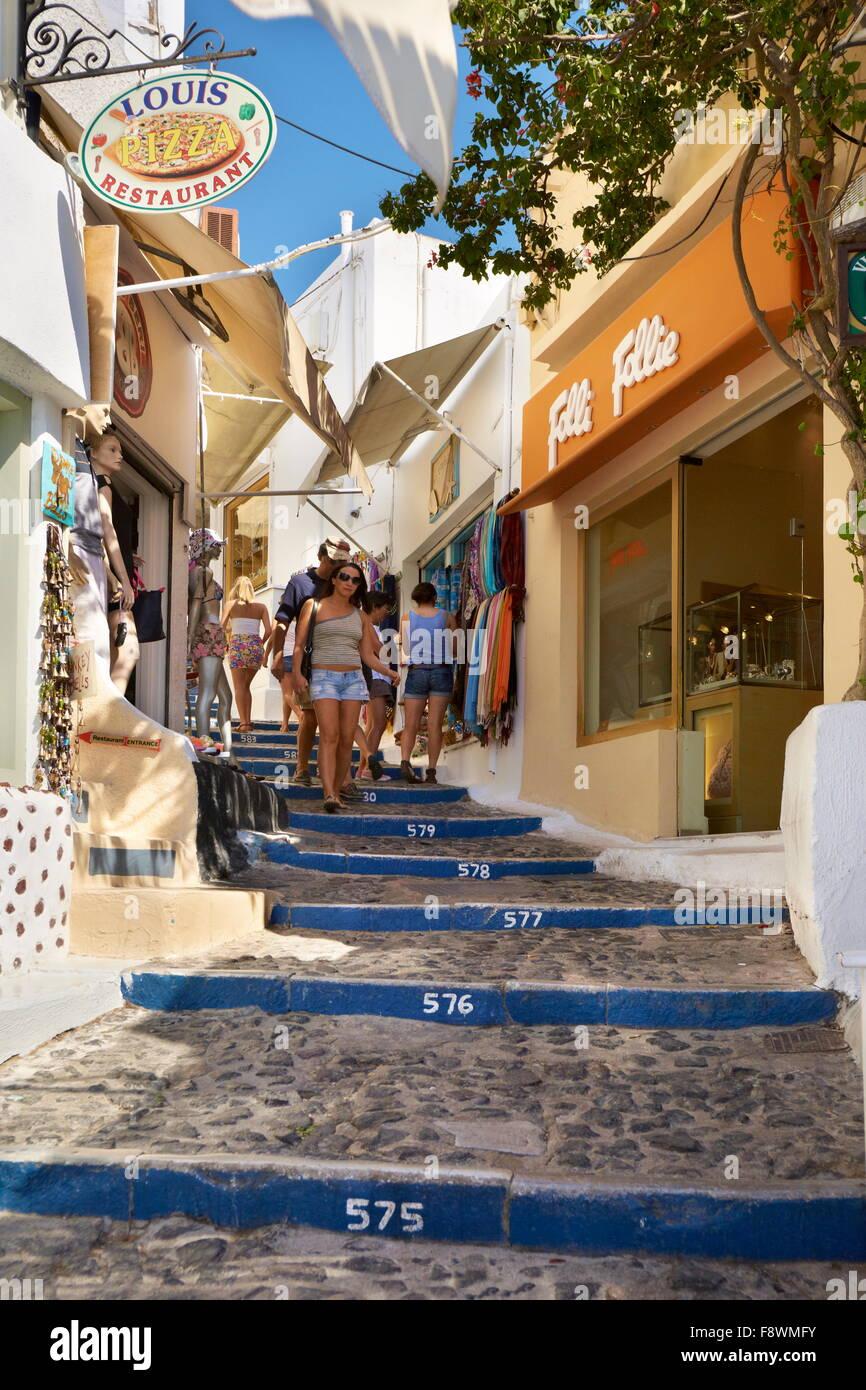 Thira (Fira) - capital city of Santorini, sidewalk with tourists, Santorini Island, Cyclades, Greece - Stock Image