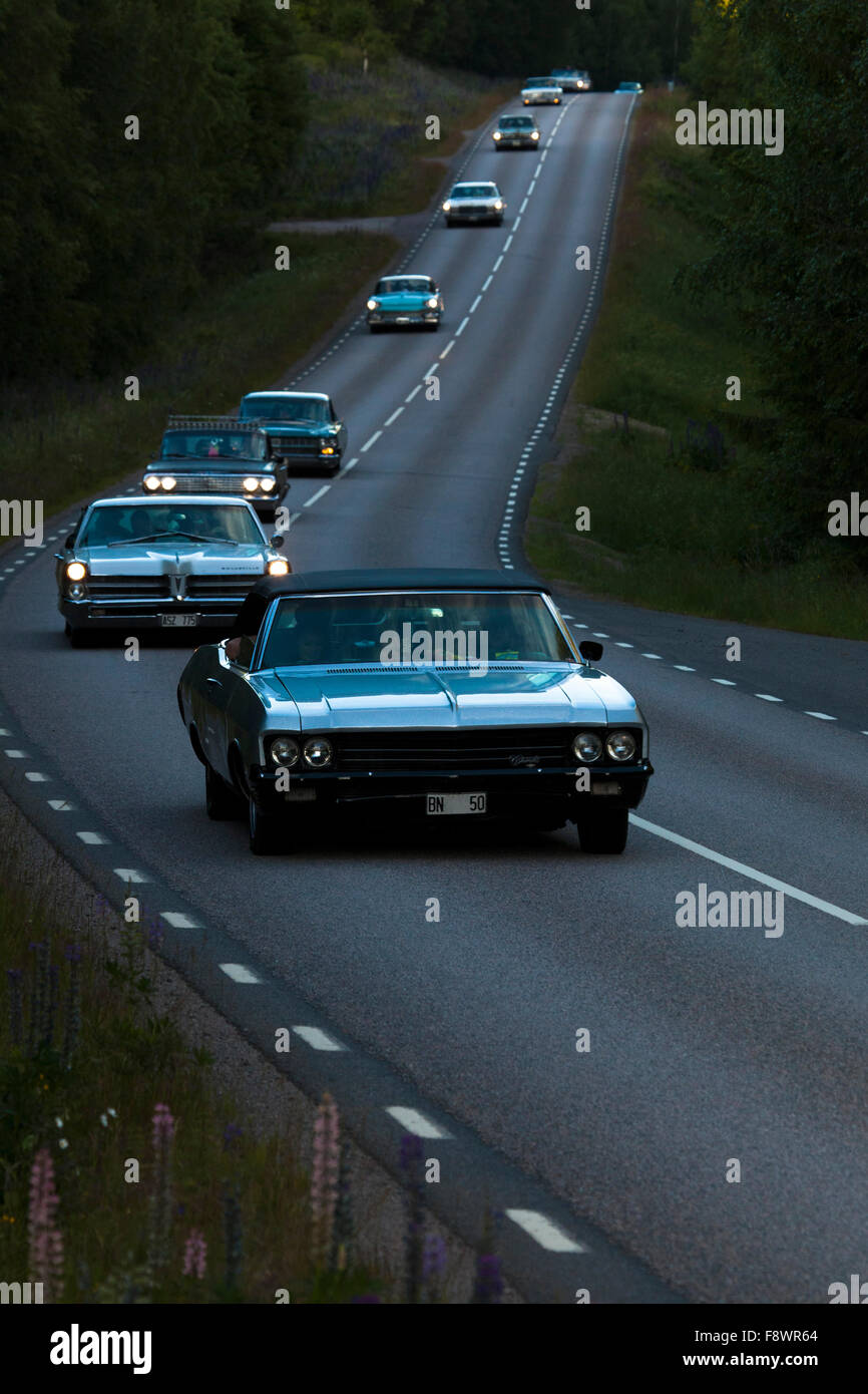 Oldtimers driving to the yearly oldtimer meeting, from Arvika to Hillringsberg, 1970 Chevrolet Impala at the front - Stock Image