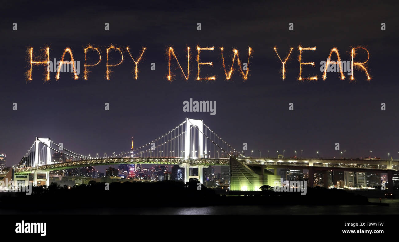 happy new year fireworks celebrating over tokyo rainbow bridge at night odaiba japan