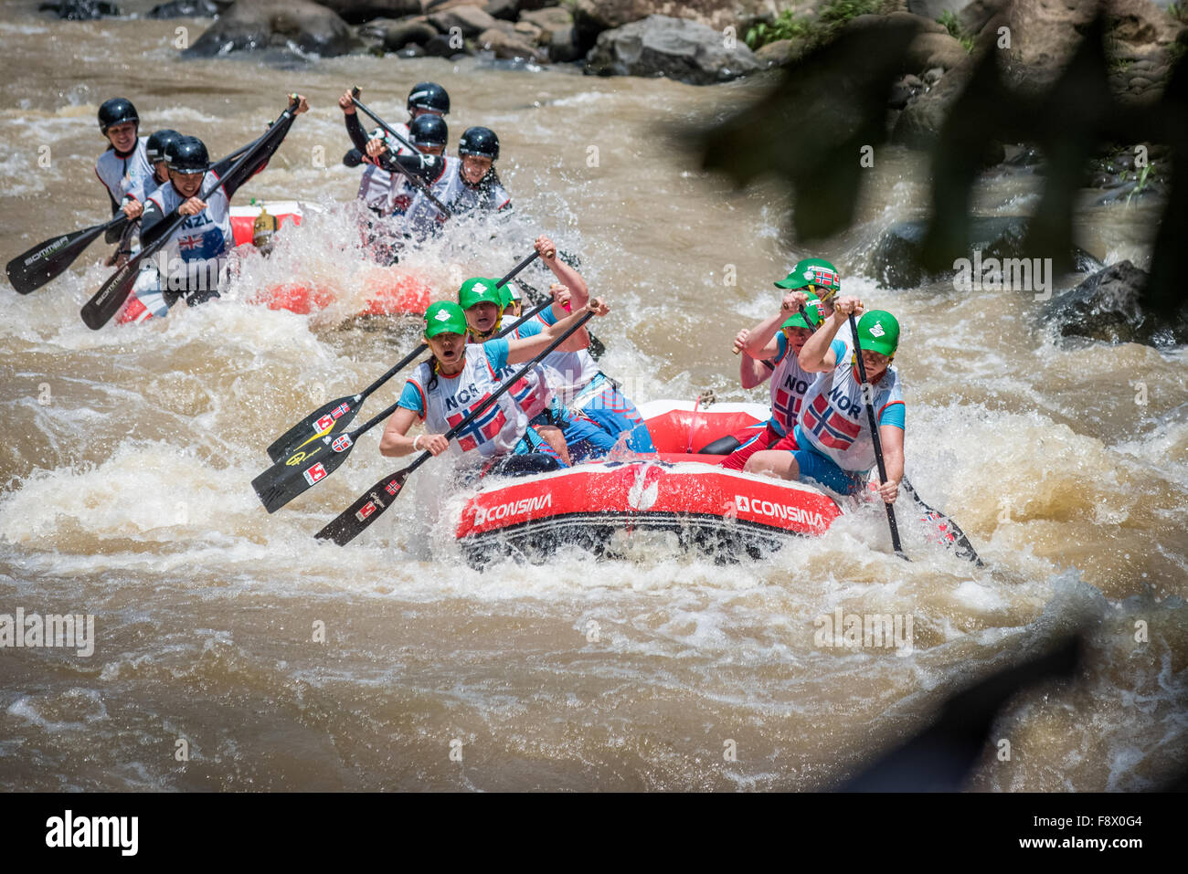 Norwegian and New Zealand master women teams compete on head to head sprint category during World Rafting Championships. - Stock Image