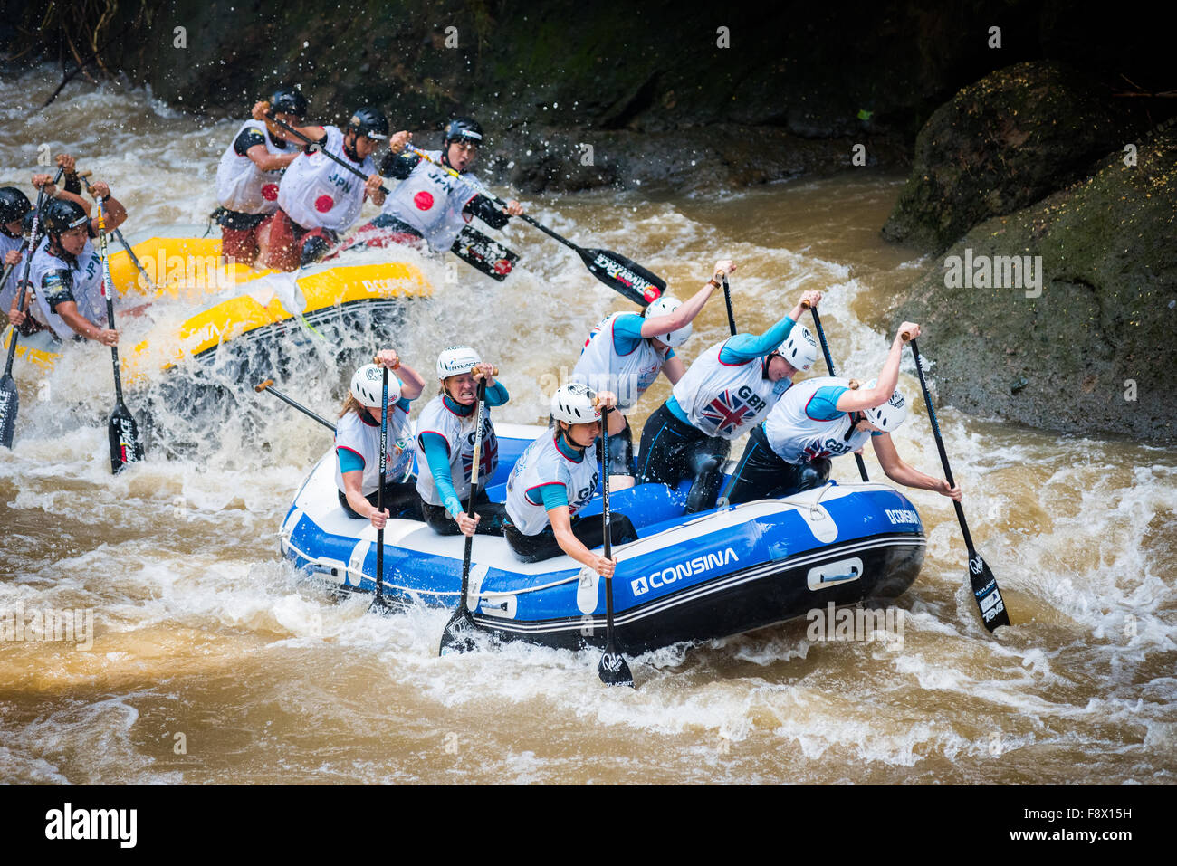 Great Britain and Japan master women teams compete on head to head sprint category during the 2015 World Rafting - Stock Image