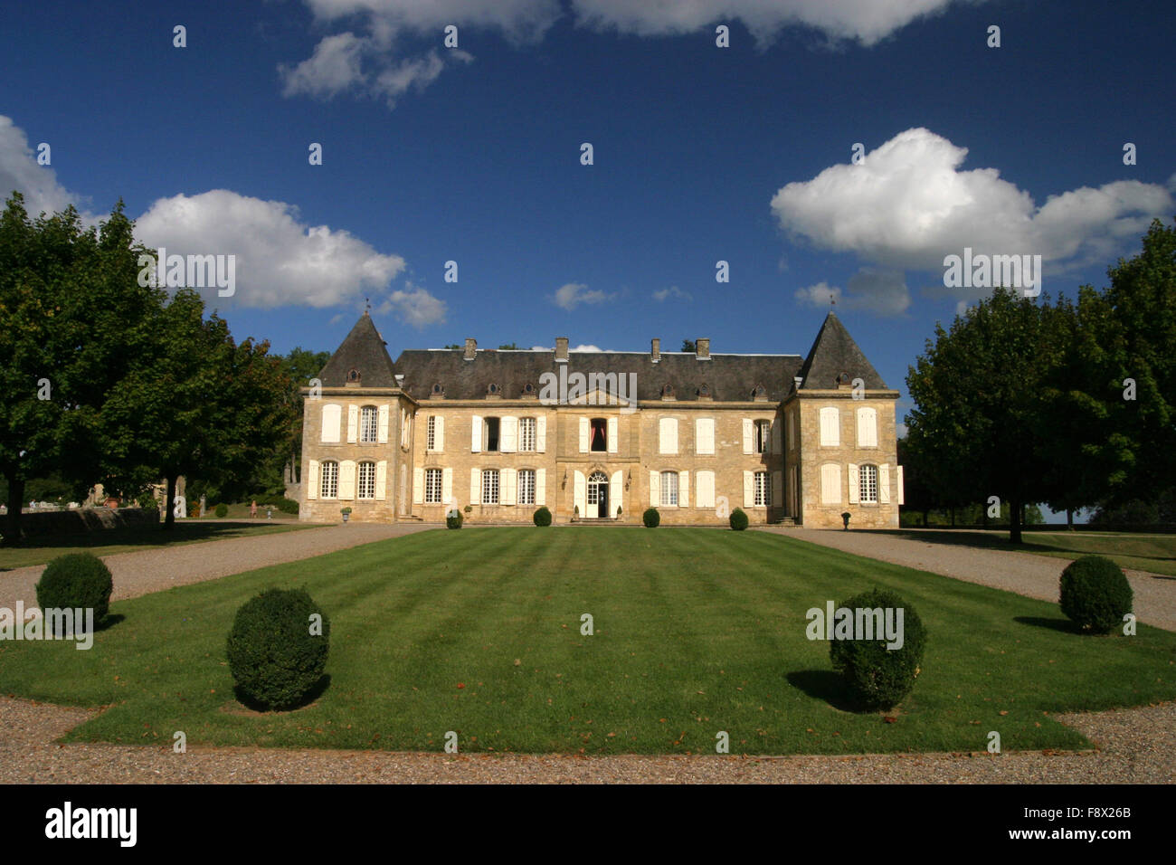Chateau Dordogne France in summer sun with blue clouds - Stock Image