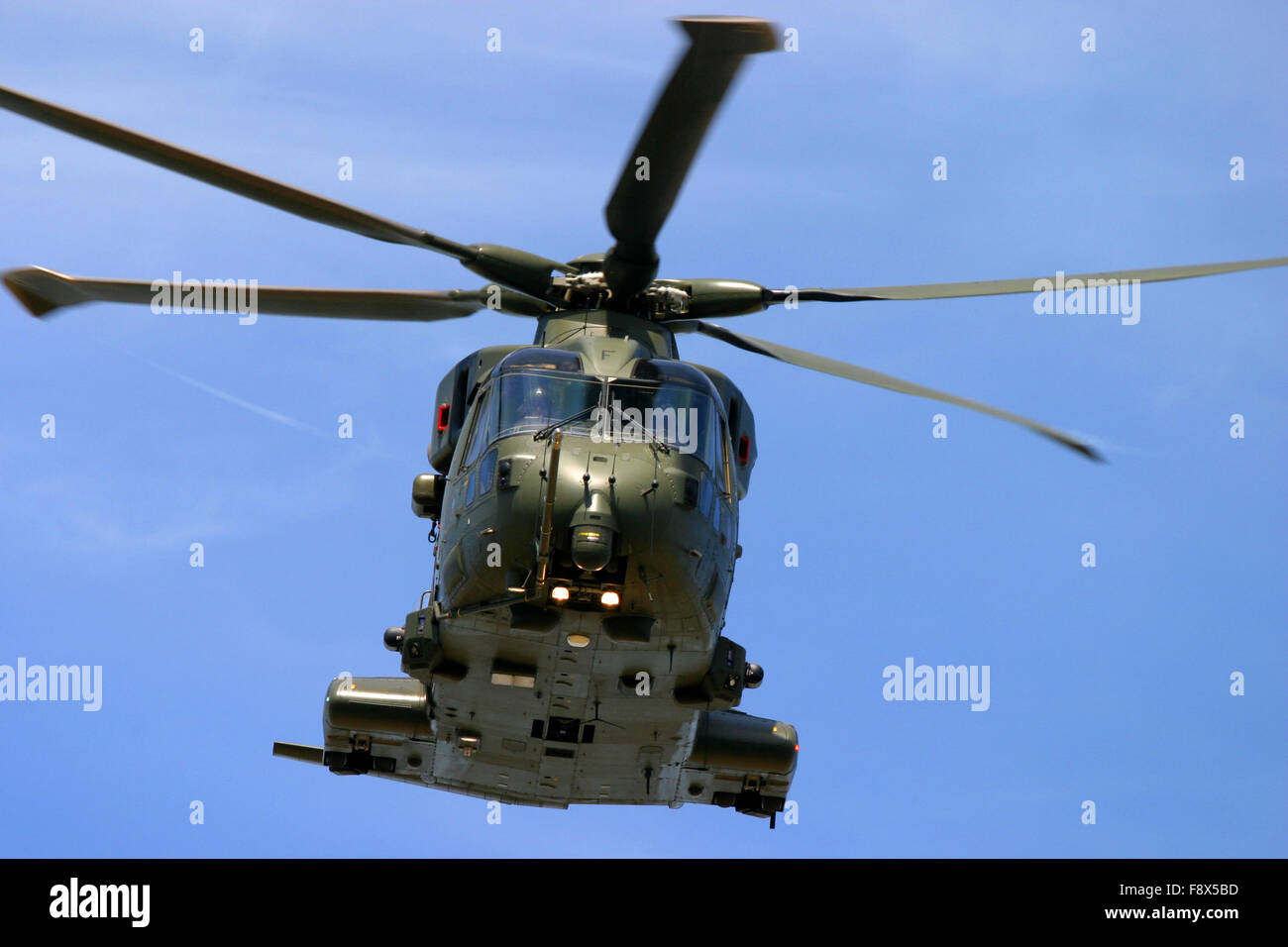 Military helicopter in flight at UK air show - Stock Image