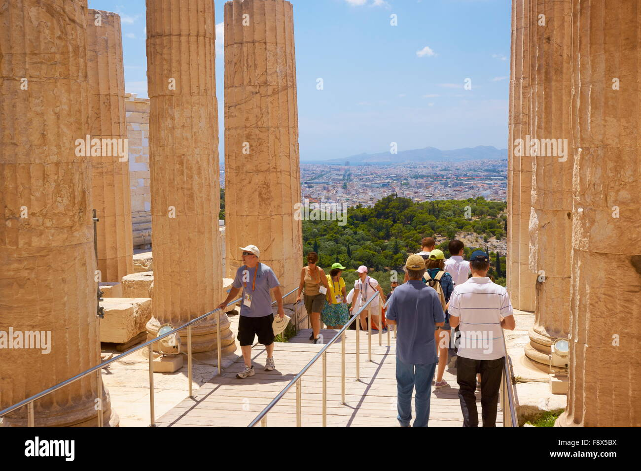 Athens - Acropolis, tourists in the passage through the Propylaea, Greece - Stock Image