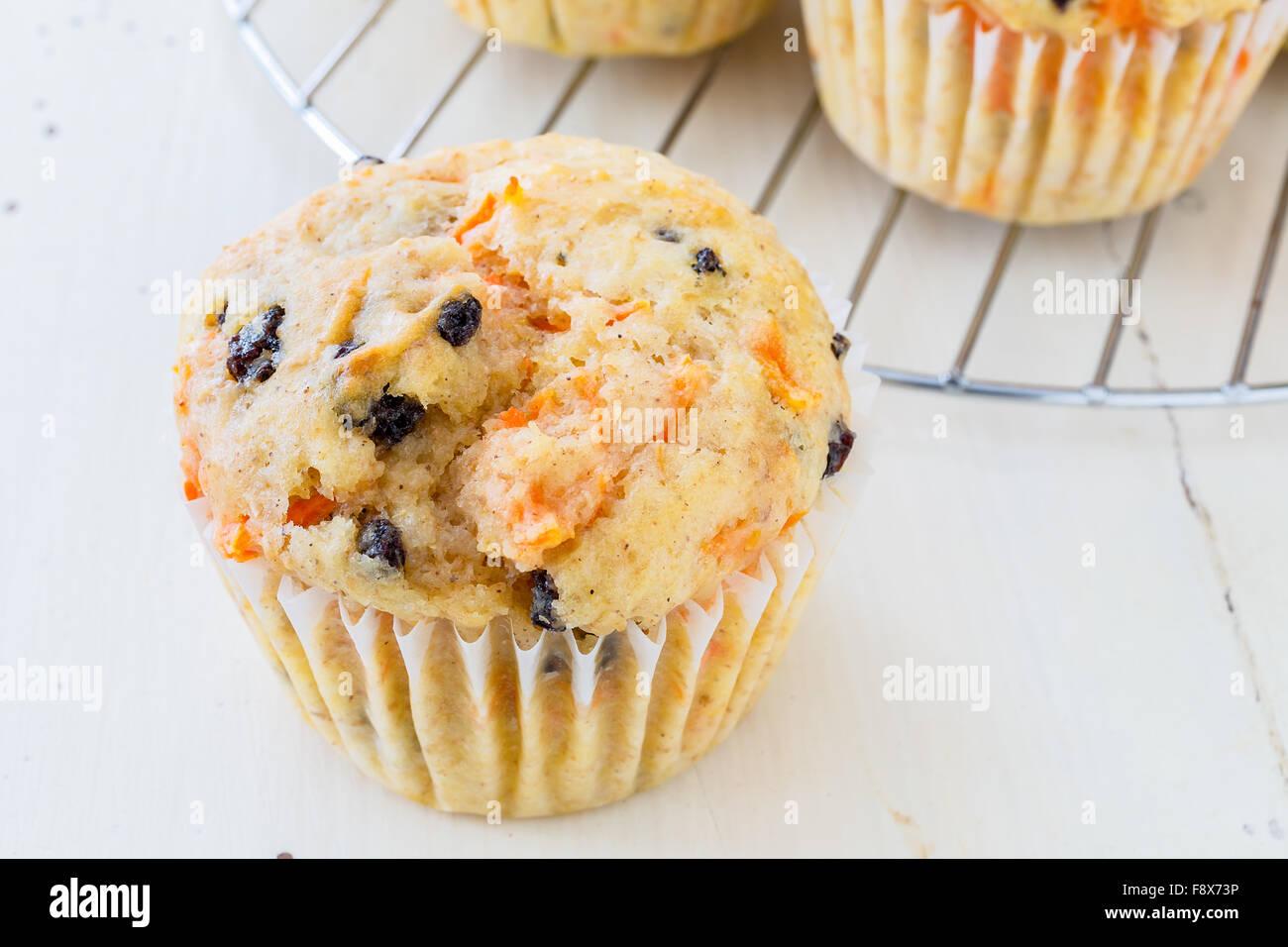 Tasty homemade carrot raisin muffins. - Stock Image