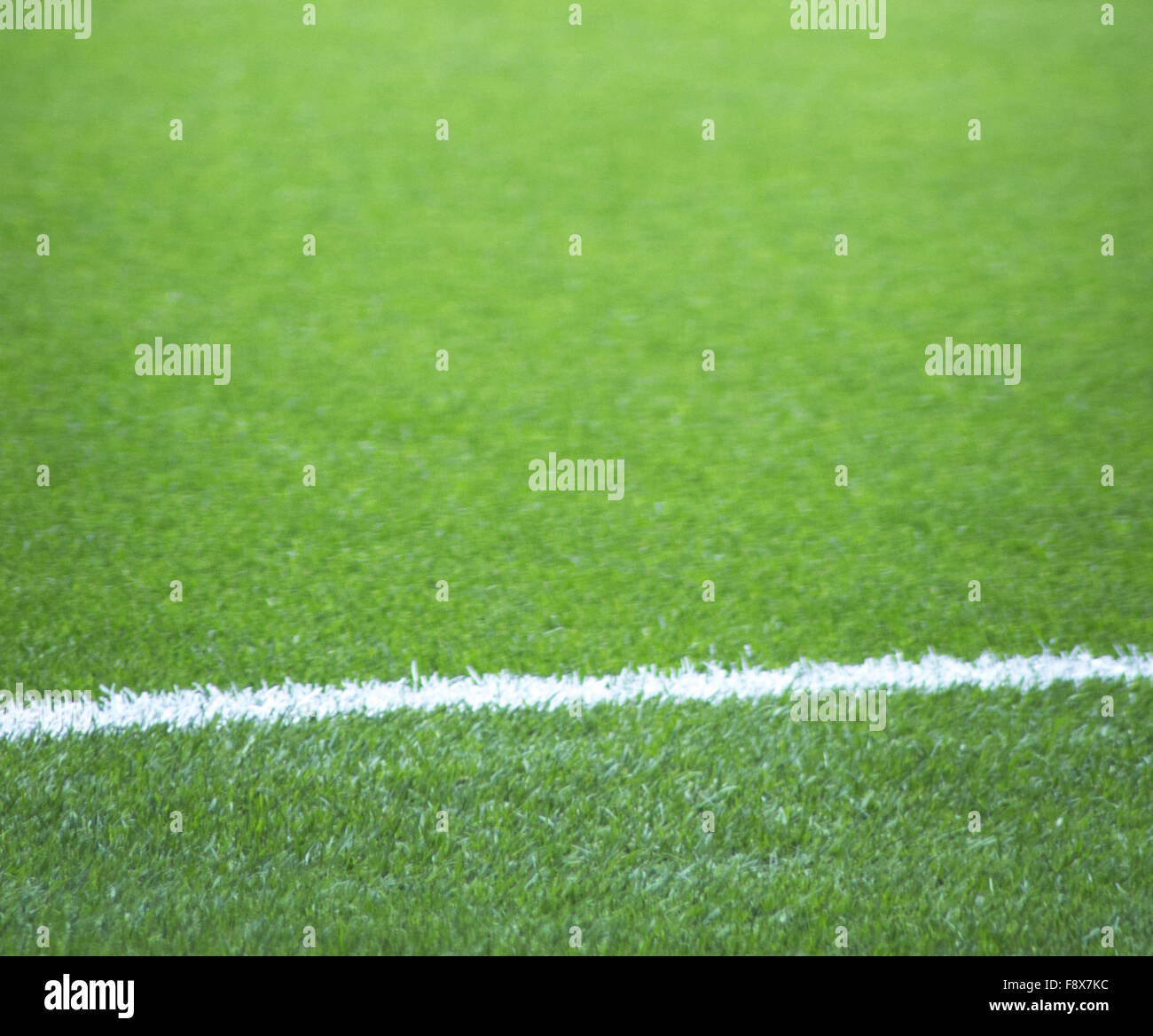 Soccer football pitch white line and grass. - Stock Image