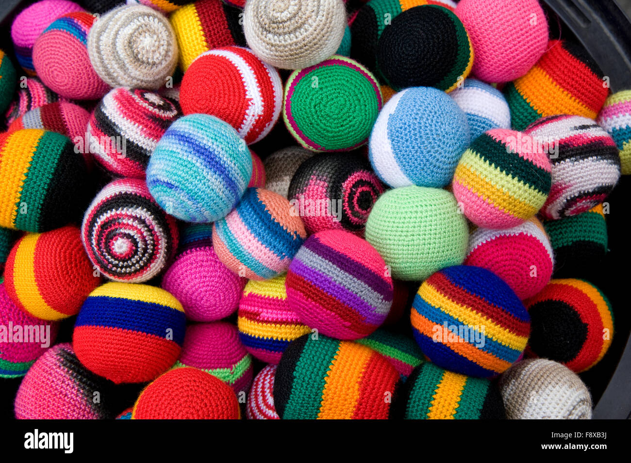 Colorful Fabric Balls On Display In Marketplace In Otavalo Ecuador Stock Photo Alamy