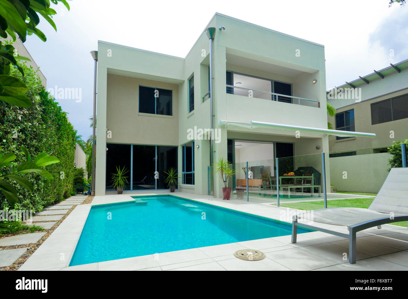 Luxurious Modern House With Swimming Pool And Backyard Stock Photo Alamy