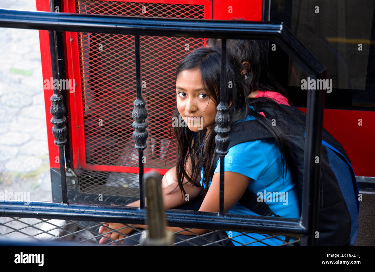 Young Ecuadoran girl on a train at the station in Ibarra. - Stock Image