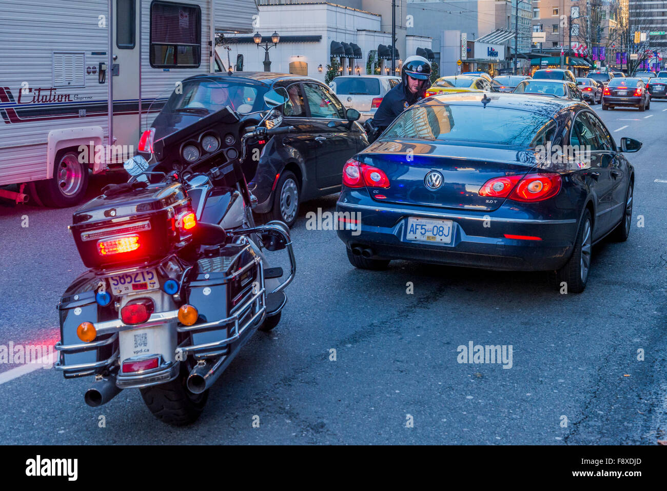 Policeman pulls over car, Vancouver, British Columbia, Canada, - Stock Image