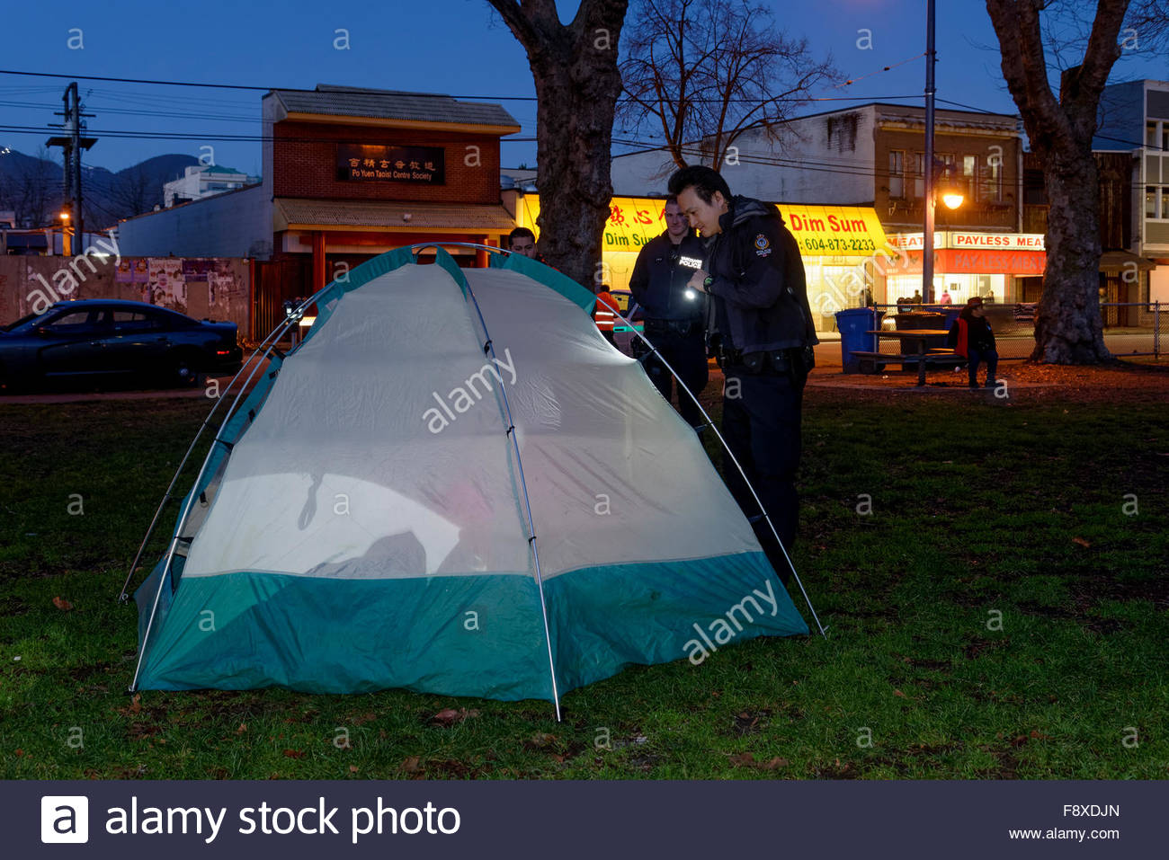 Homeless person in illegal tent gets confronted by police at Oppenheimer Park, Vancouver, British Columbia, Canada, - Stock Image