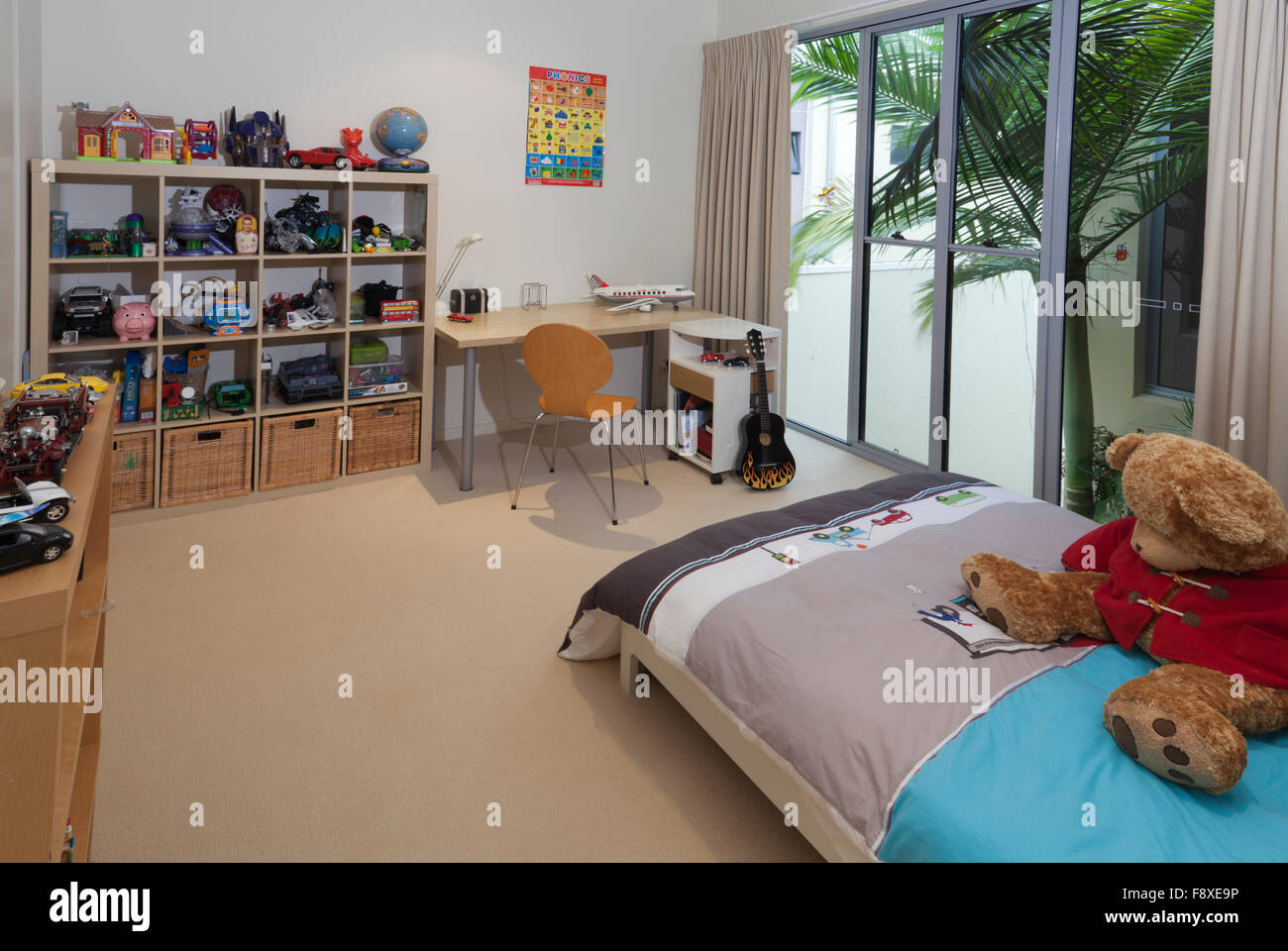 Young boy\'s bedroom with bed, toys and desk Stock Photo ...