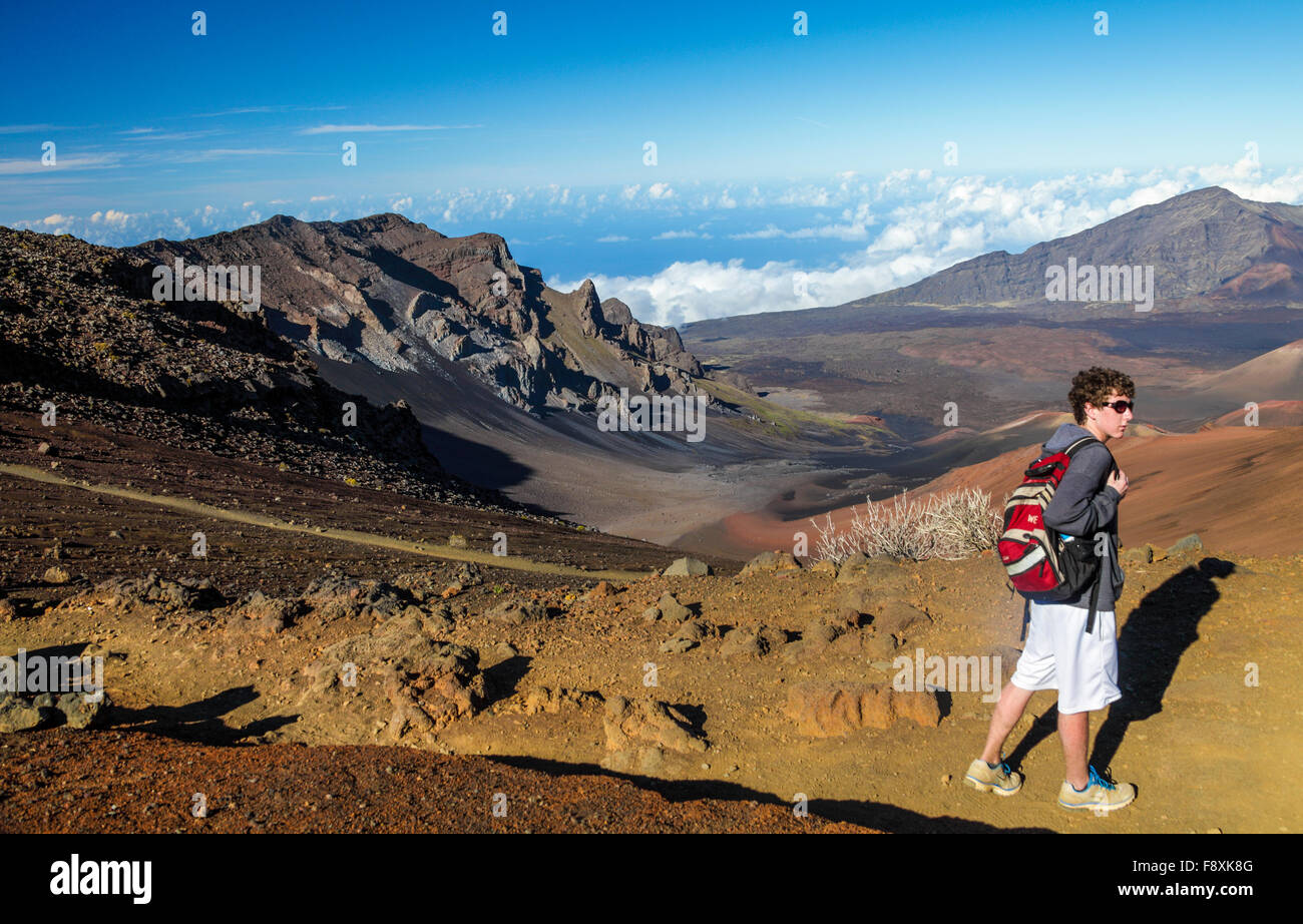 Teenager hikes the Sliding Sands Trail at Haleakala National Park on Maui - Stock Image