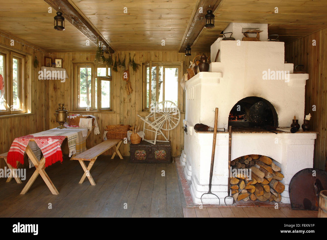 Interior of russian house with traditional oven - Stock Image