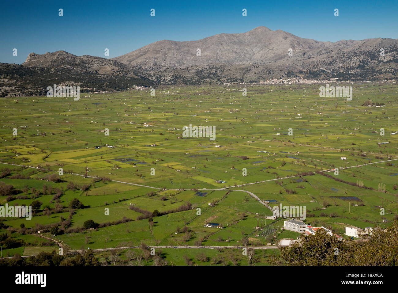 Field and settlement pattern, with flooded areas, on The Lassithi plateau in spring, Crete. A large inwardly-draining Stock Photo