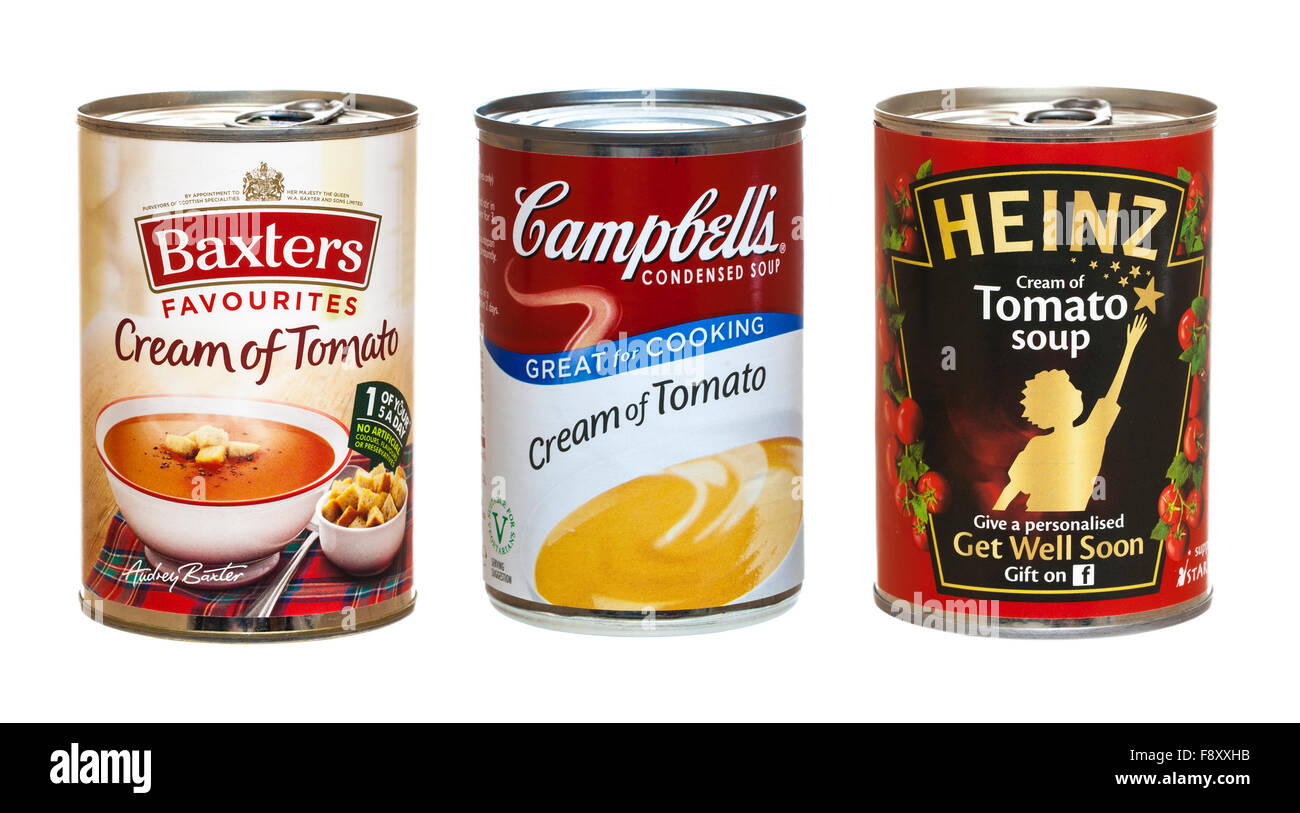Three Tins of Tomato Soup On a White Background - Stock Image