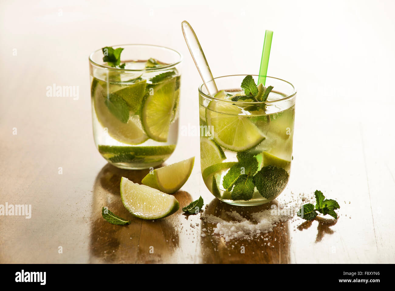 Cold Mojito cocktail on a rustic table close up. - Stock Image