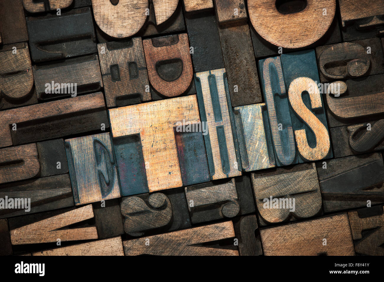 ethics word made from wooden letterpress blocks inside many letters background - Stock Image