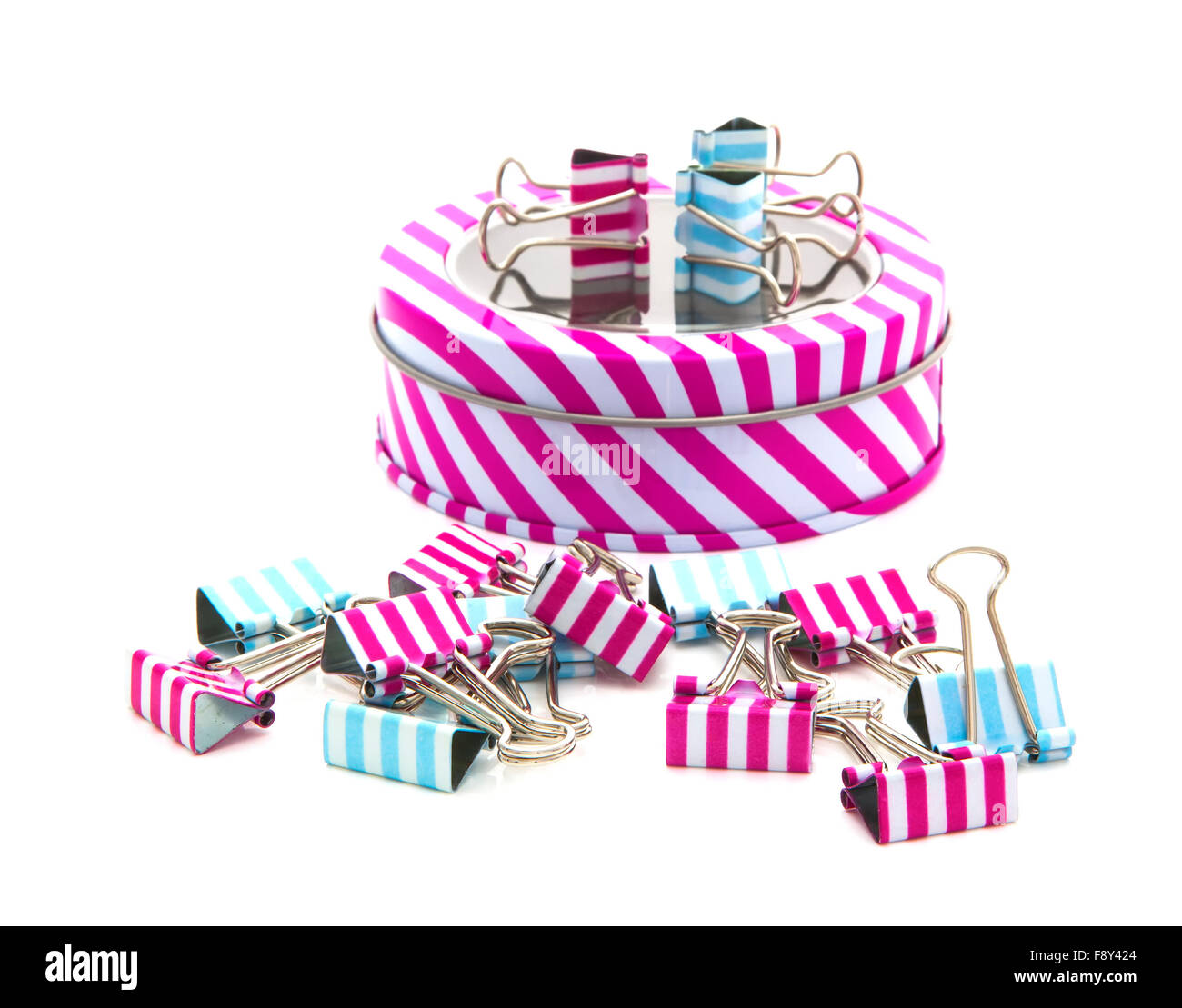 Stripey Tin with foldback clip's of a white background - Stock Image