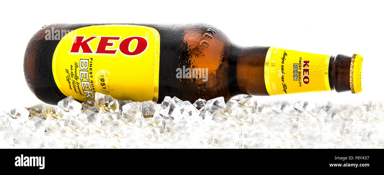 Bottle of KEO beer from Cyprus on a bed of ice over a white background. - Stock Image