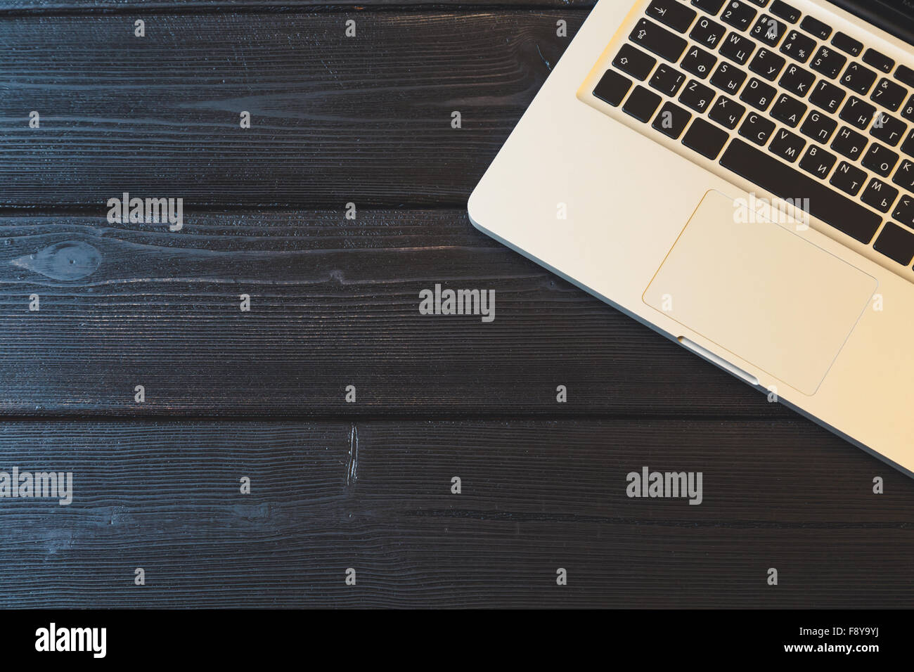 Laptop on modern wooden desk - Stock Image