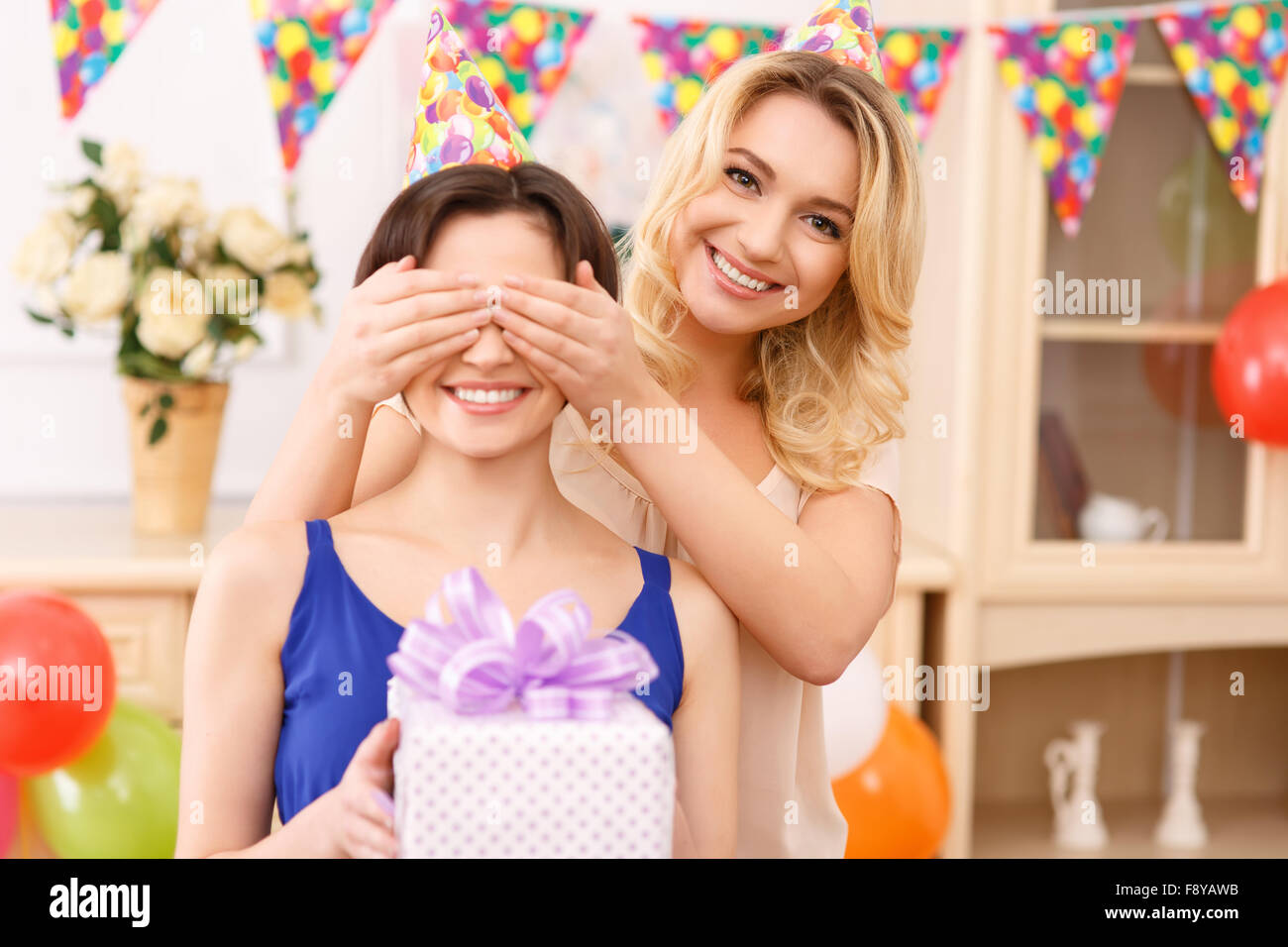 Girls having fun during birthday celebration. - Stock Image