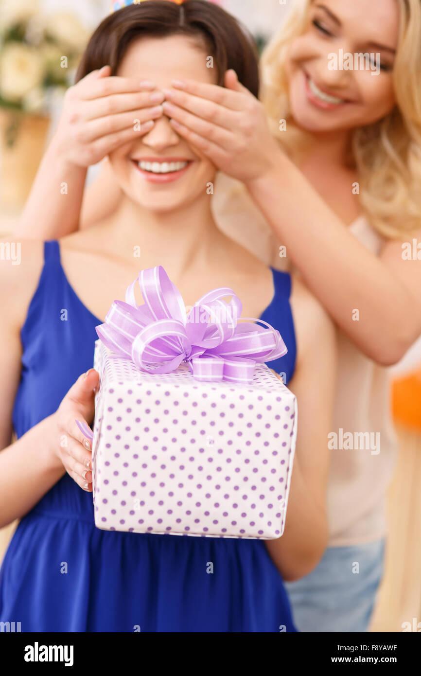 Girls having fun during birthday celebration - Stock Image