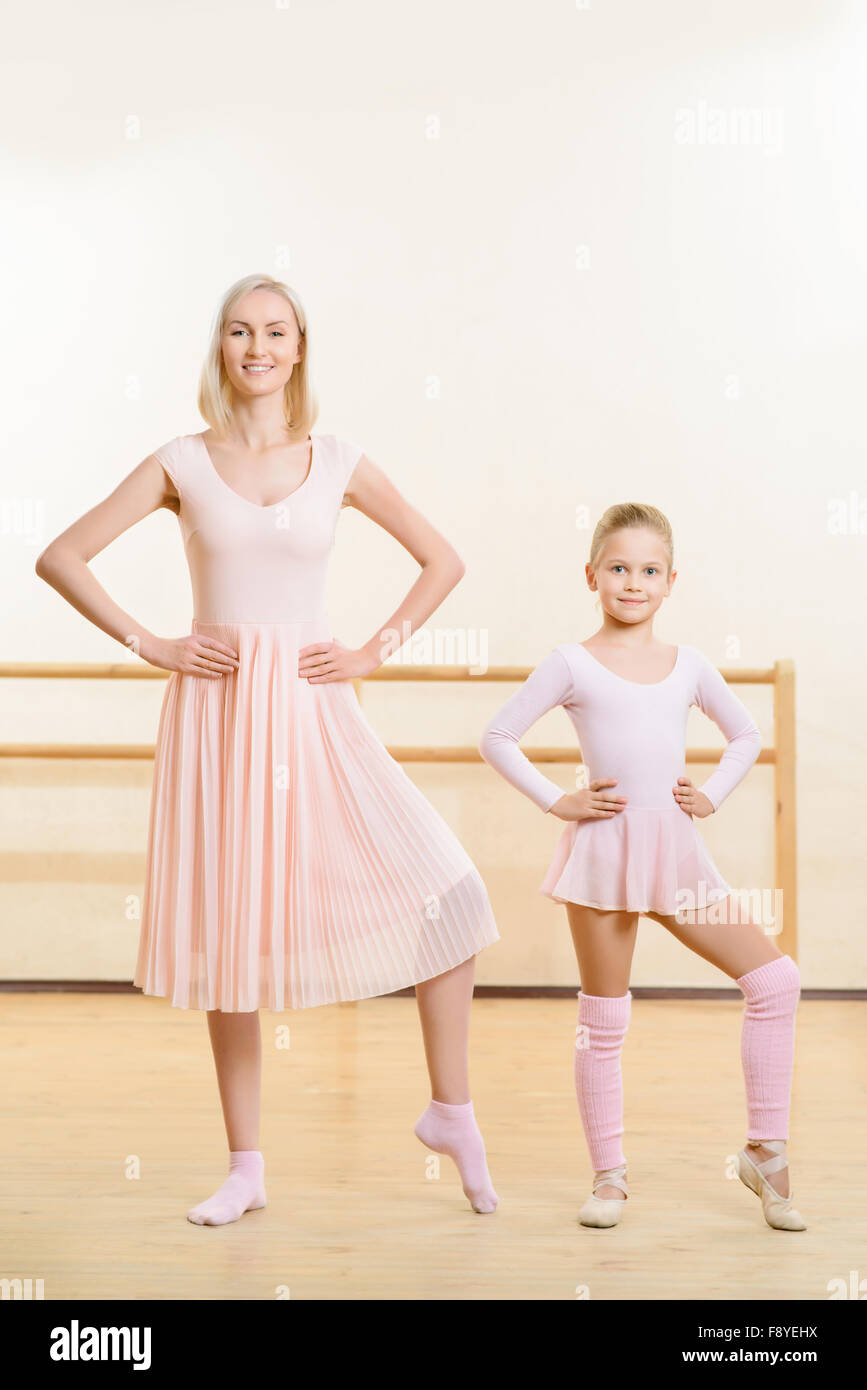 Ballet teacher and her apprentice are busy dancing. - Stock Image
