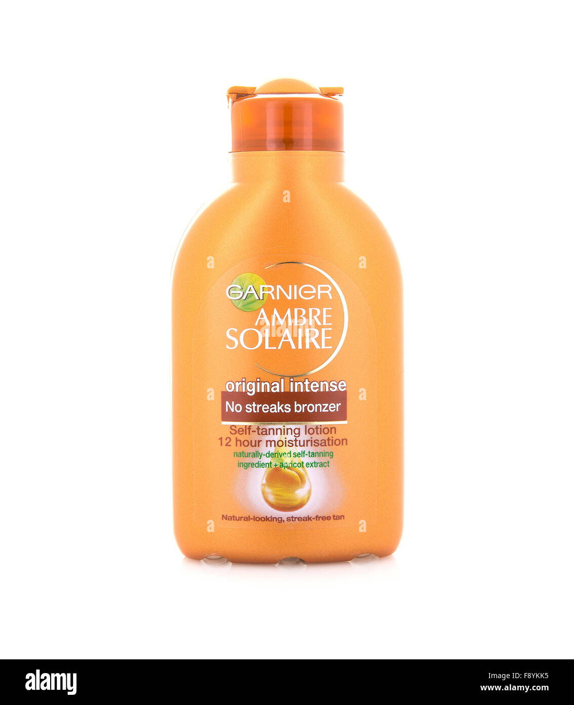 Garnier Ambre Solaire 12 Hour Self Tanning Lotion on a White Background - Stock Image