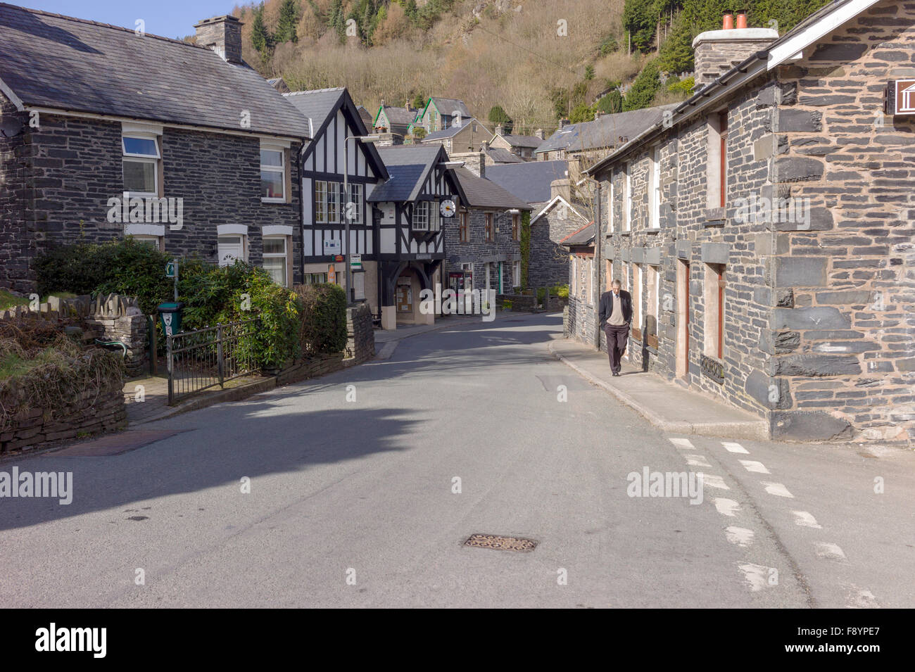 A view of Corris village main street with the black and white half timbered Corris Instittute amongst the small - Stock Image