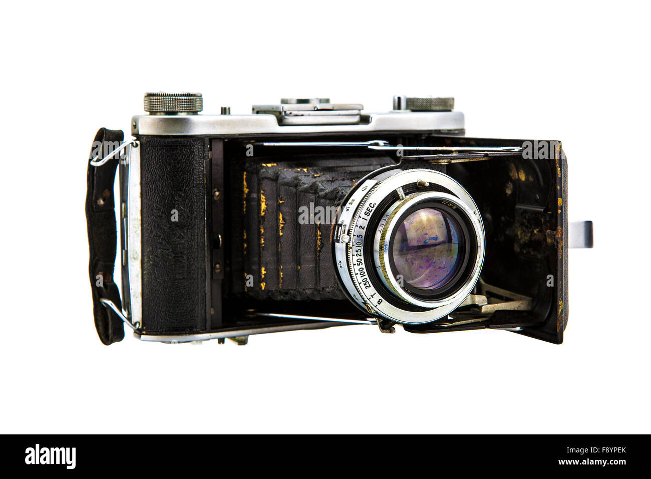 Old well worn vintage film camera on white background - Stock Image