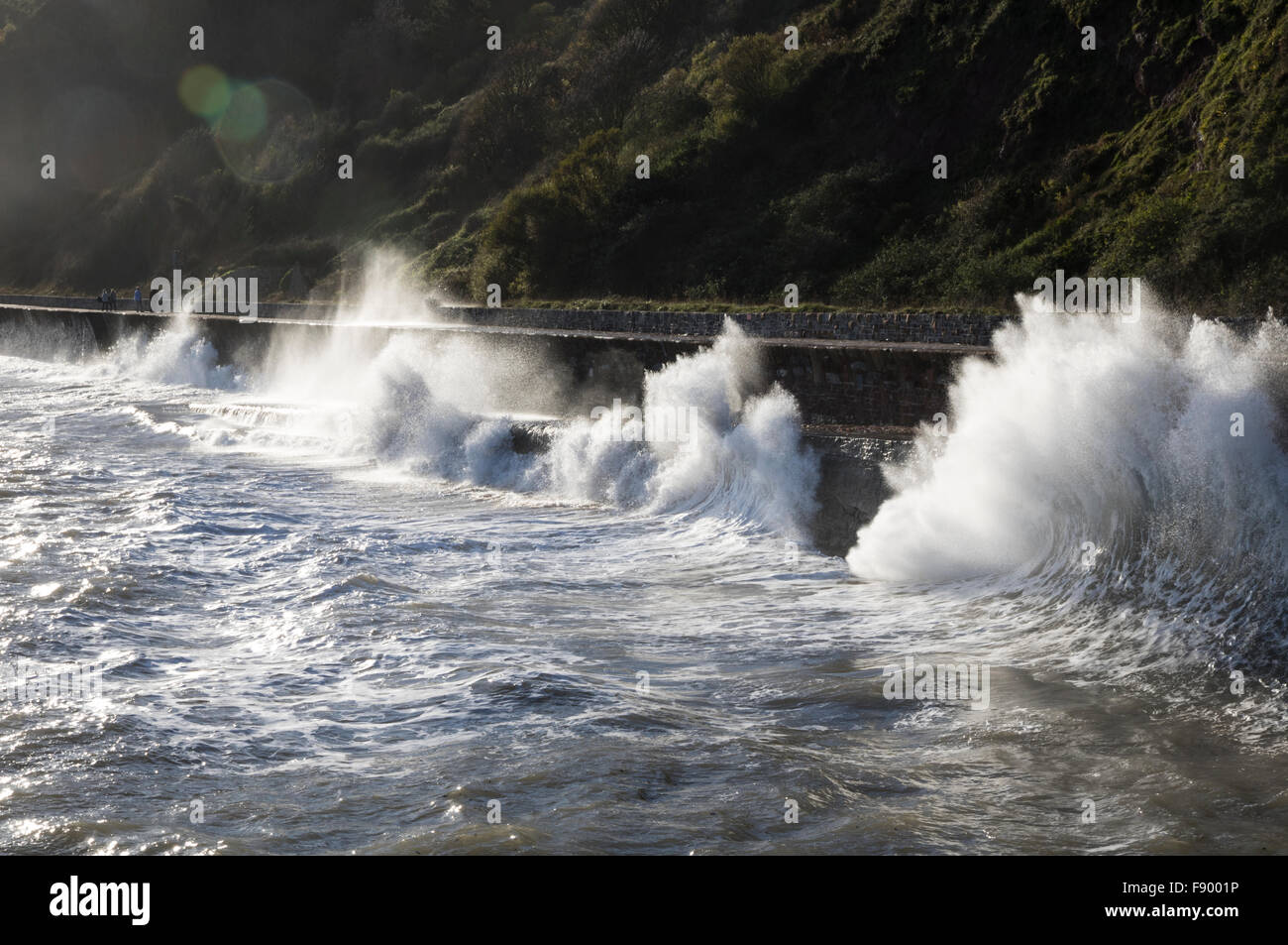 Waves breaking onto the promenade at Teignmouth Stock Photo