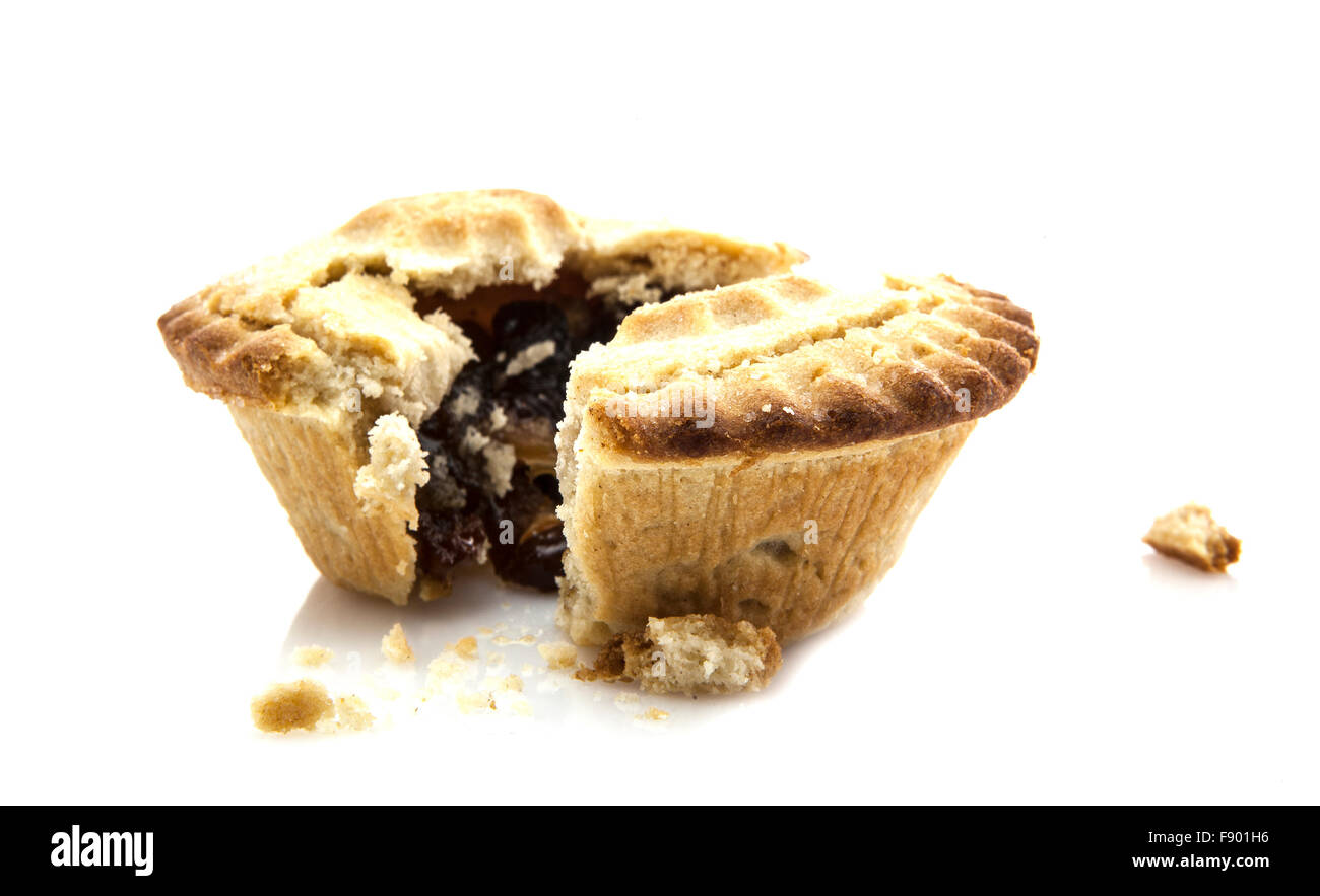Mince Pie broken in half showing mince on white background Stock Photo