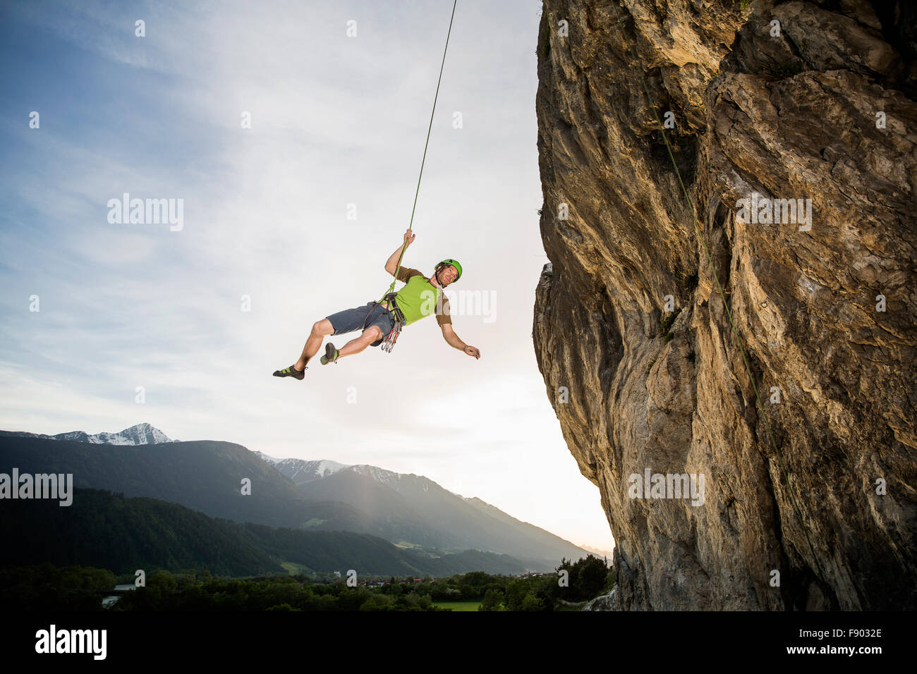 Climber hanging on the rope by the cliff, Martinswand, Zirl, Tyrol, Austria - Stock Image