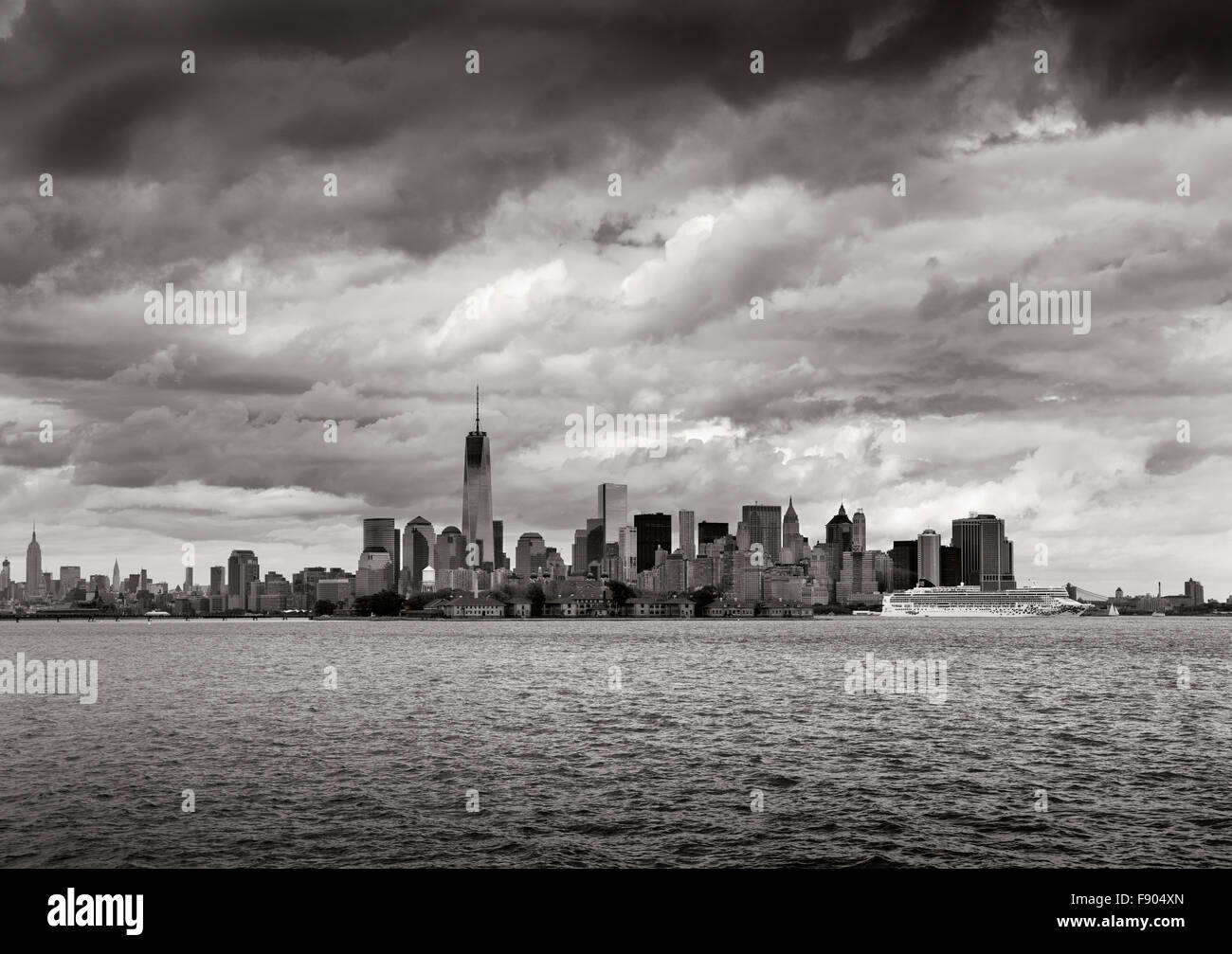 New York Harbor Black & White view of Lower Manhattan skyscrapers, New York. One World Trade Center rises towards - Stock Image