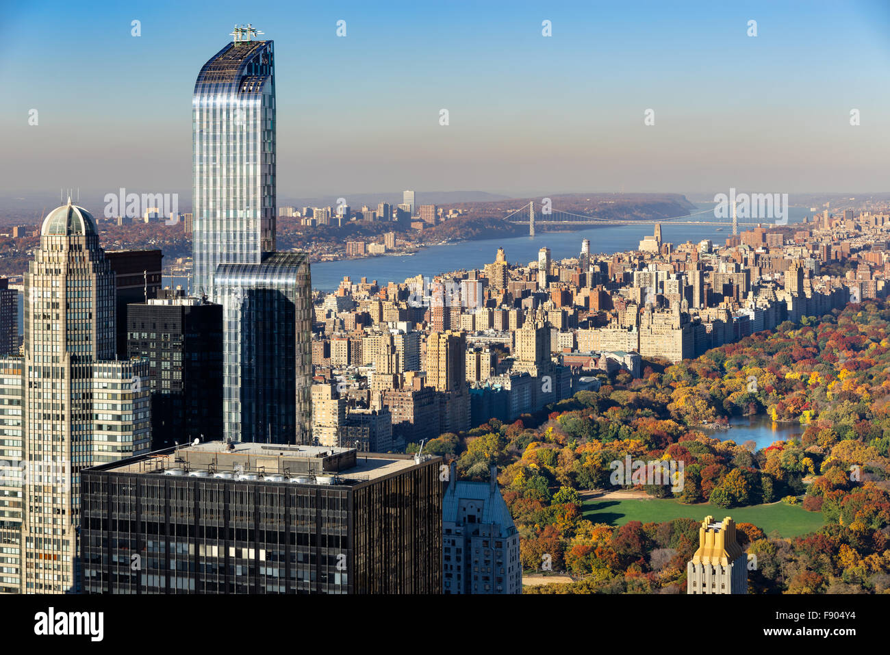 Aerial View of Central Park in Fall, Upper West Side with Midtown skyscrapers and the Hudson River, New York City. - Stock Image