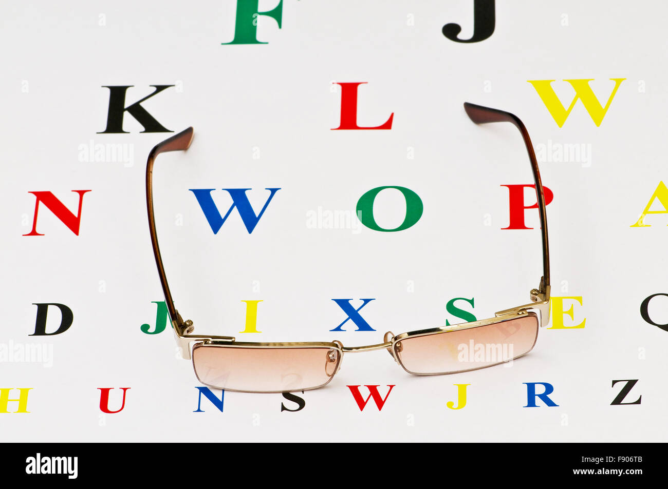 Opical glasses over the eye test table Stock Photo