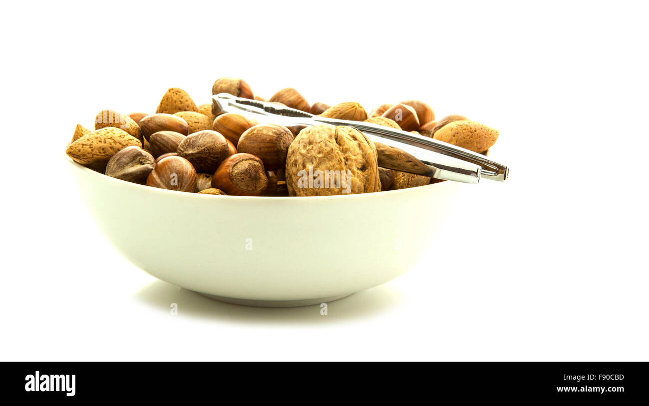 Mixed nuts in shells selection of Brazil,almonds,walnuts and hazelnuts isolated on white background - Stock Image